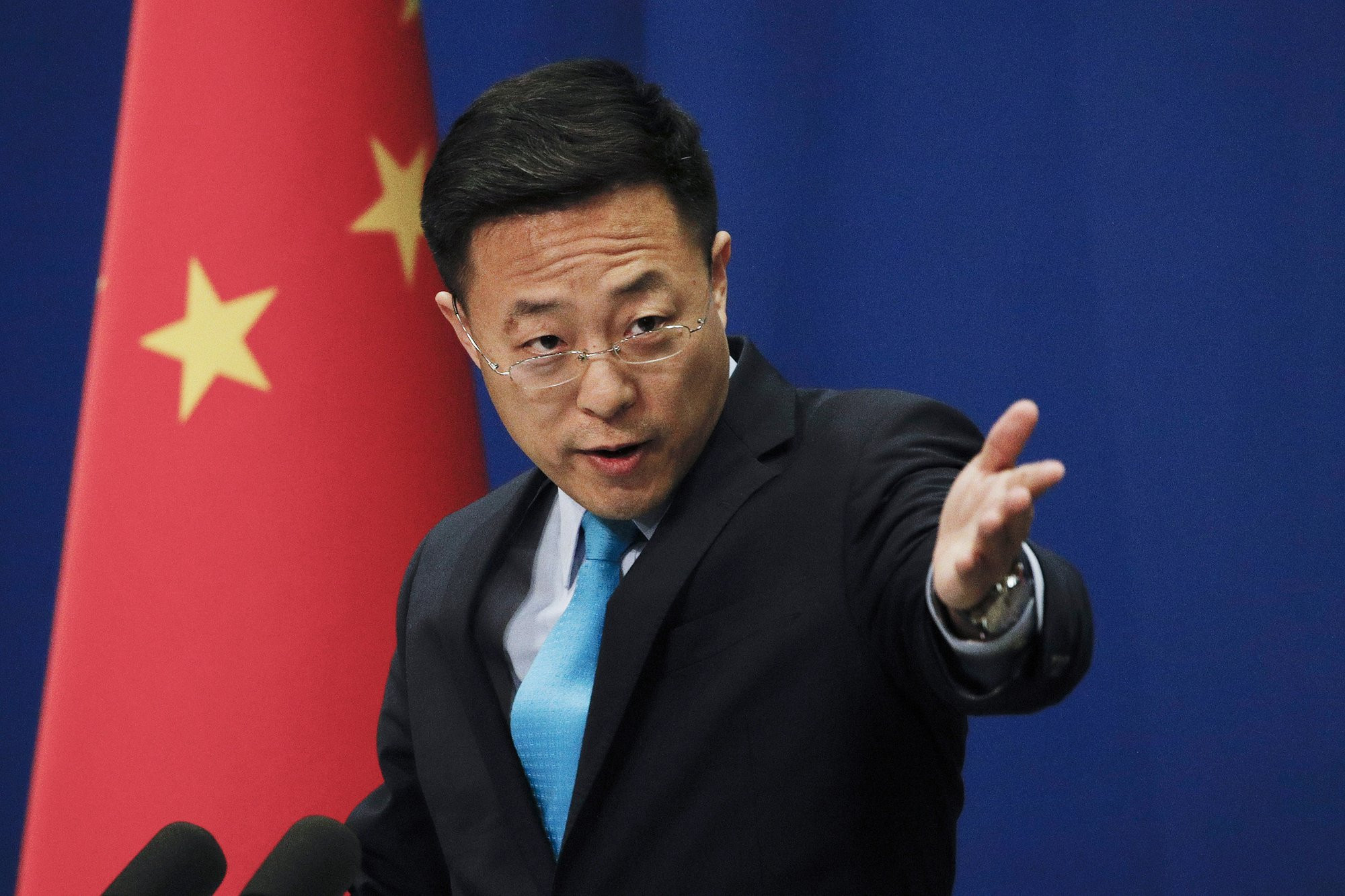 In this Monday, Feb. 24, 2020 file photo, Chinese Foreign Ministry spokesman Zhao Lijian speaks during a daily briefing at the Ministry of Foreign Affairs office in Beijing.