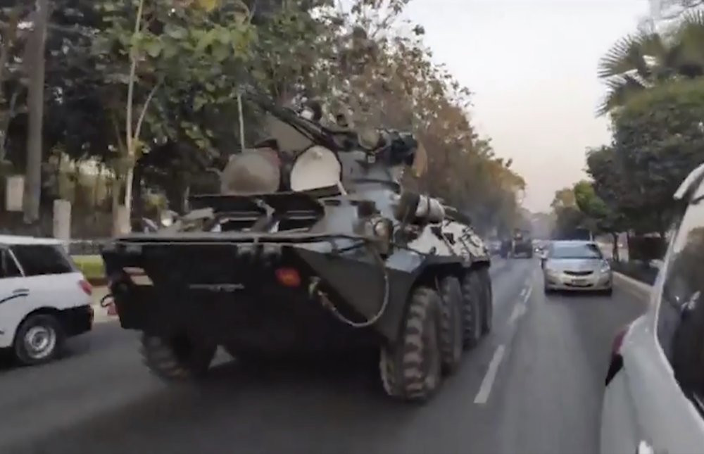 In this image made from video by the Democratic Voice of Burma (DVB), two armored personnel carriers were seen traversing on a road in Yangon, Myanmar, Sunday, Feb. 14, 2021.
