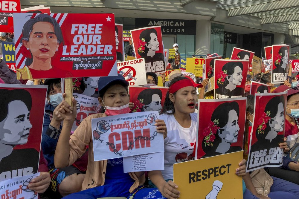 Demonstrators display images of detained Myanmar leader Aung San Suu Kyi during a protest against the military coup in Yangon, Myanmar, Tuesday, Feb. 16, 2021.