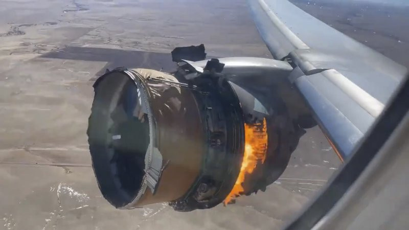 In this image taken from video, the engine of United Airlines Flight 328 is on fire after after experiencing