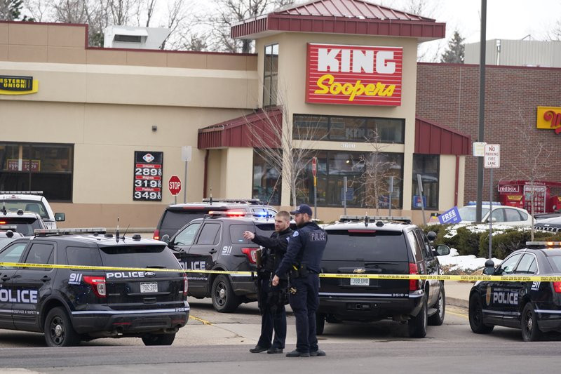 Police work on the scene outside of a King Soopers grocery store where a shooting took place Monday, March 22, 2021, in Boulder, Colorado.