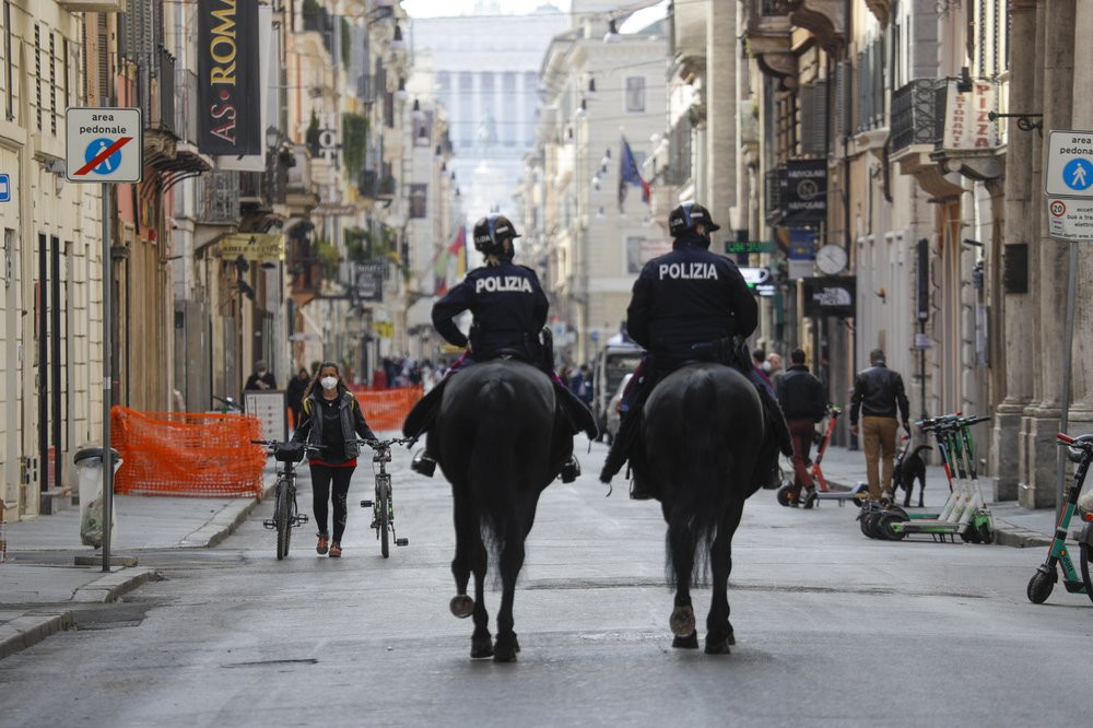Mounted police officers patrol Via del Corso main shopping street, in downtown Rome, Saturday, April 3, 2021. Italy went into lockdown on Easter weekend in its effort to battle then Covid-19 pandemic.
