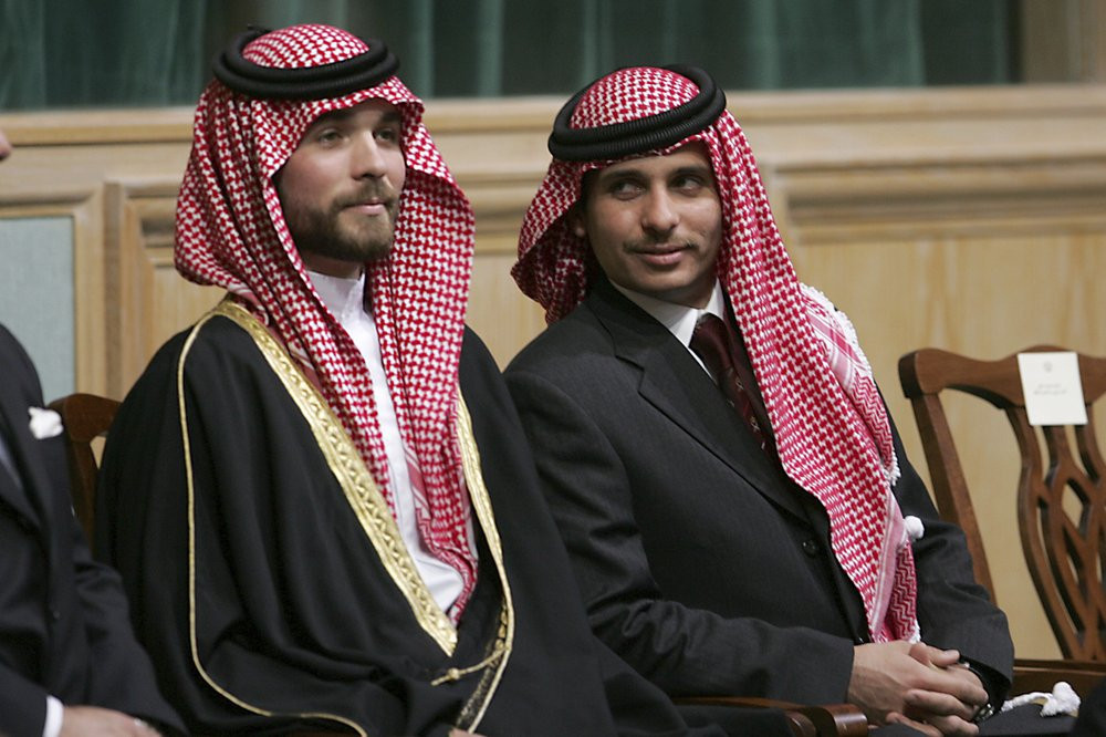 In this Tuesday, Nov. 28, 2006 file photo, Prince Hamza Bin Al-Hussein, right, and Prince Hashem Bin Al-Hussein, left, brothers of King Abdullah II of Jordan, attend the opening of the parliament in Amman, Jordan.