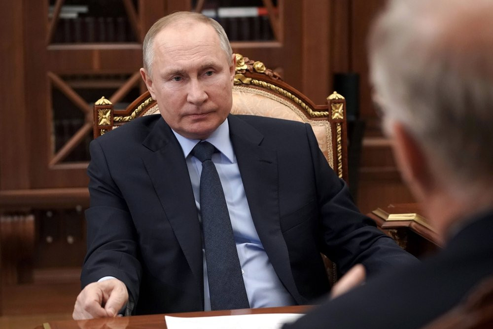 Russian President Vladimir Putin listens to General Director of the Russian Direct Investment Fund Krill Dmitriev at the Kremlin in Moscow, Russia, Friday, April 2, 2021.