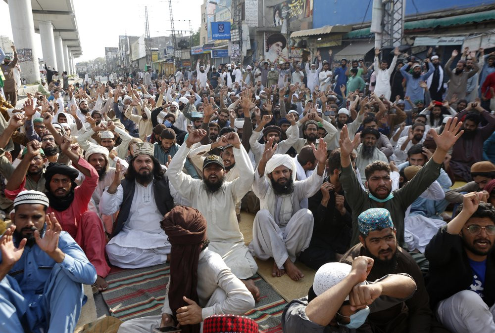 Supporters of Tehreek-e-Labiak Pakistan, a radical Islamist political party, chant slogans during a protest against the arrest of their party leader, Saad Rizvi, in Lahore, Pakistan, Thursday, April 15, 2021.