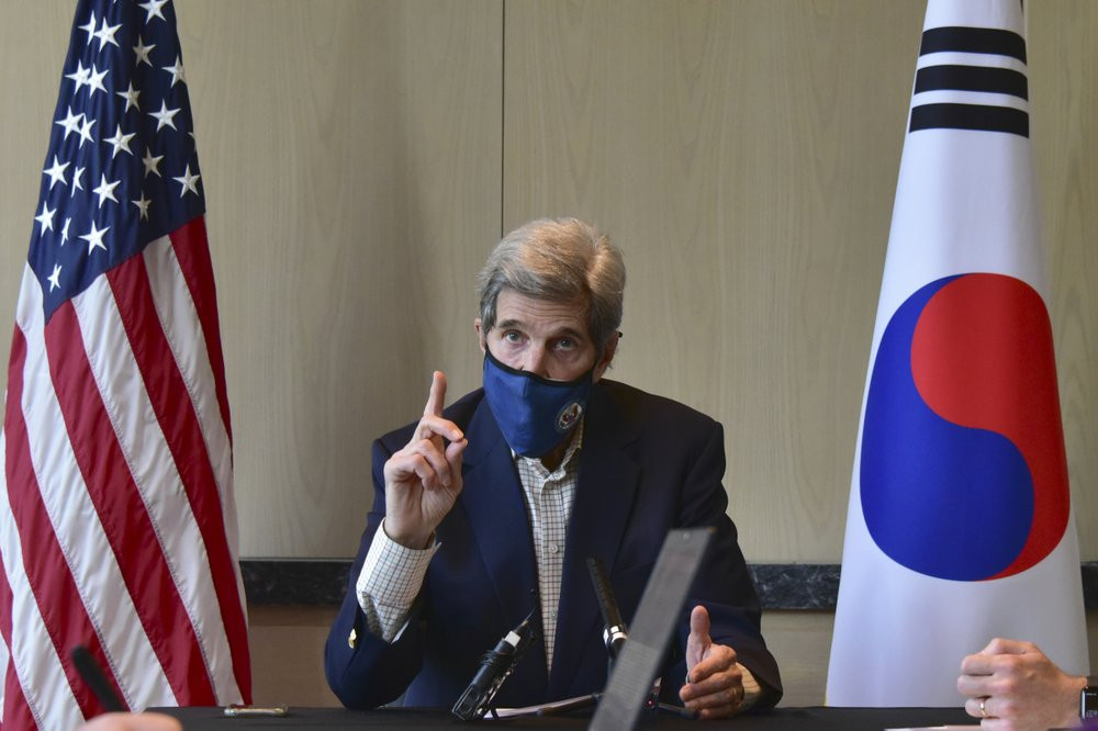 In this photo provided by U.S. Embassy Seoul, U.S. special envoy for climate John Kerry speaks during a round table meeting with the media in Seoul, South Korea, Sunday, April 18, 2021.