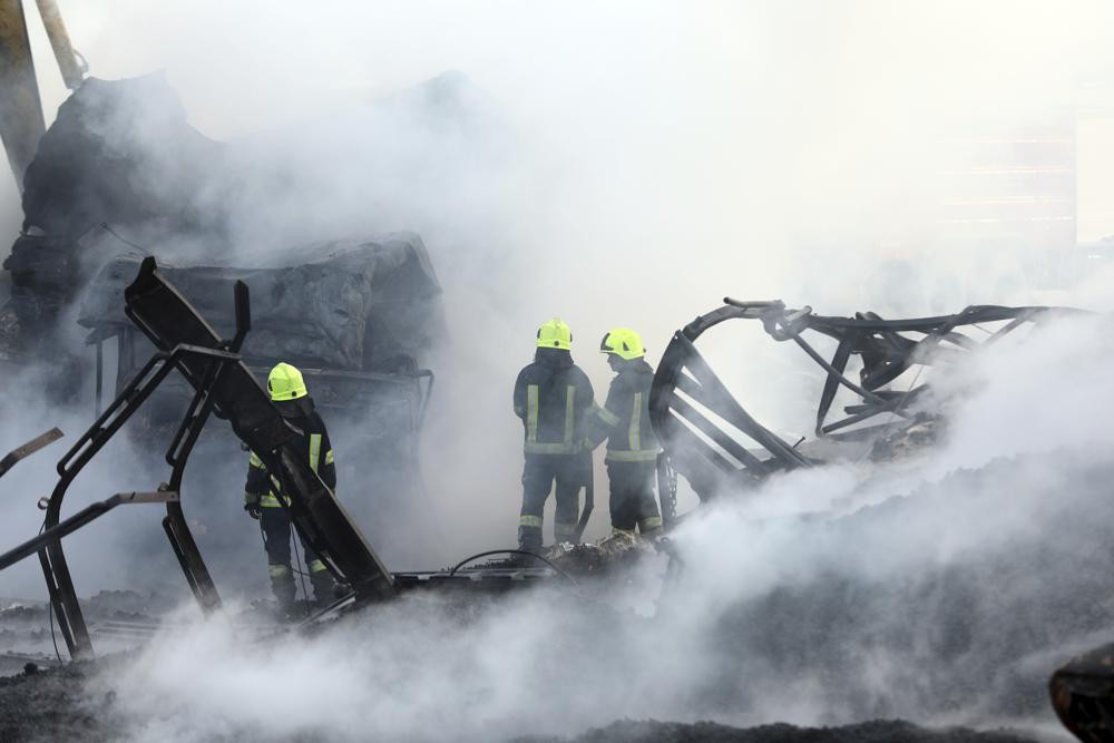 Firefighters work to extinguish burning fuel tankers in Kabul, Afghanistan, Sunday, May 2, 2021.