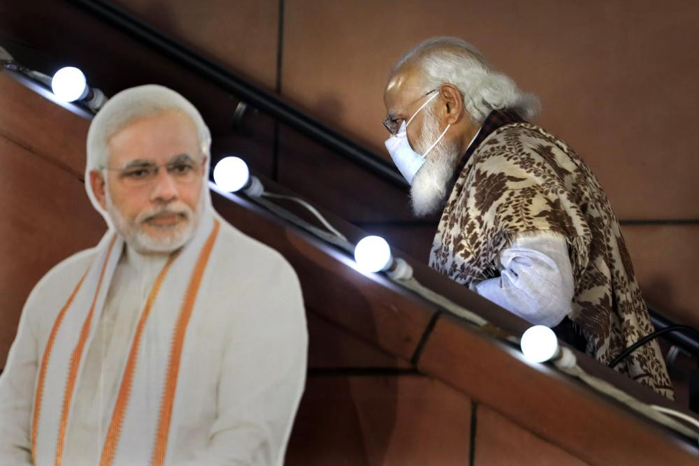 In this Nov. 11 2020, file photo, Indian Prime Minister Narendra Modi leaves after a function at the Bharatiya Janata Party headquarters following a state election in New Delhi, India.