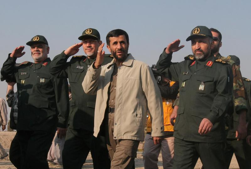 In this Nov. 26, 2006 file photo, then Iranian President Mahmoud Ahmadinejad, third left, reviews Basij paramilitary volunteers, affiliated to the elite Revolutionary Guard, at a parade ceremony in Tehran, Iran.