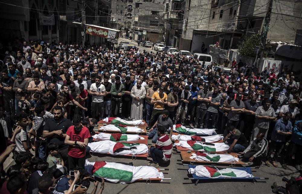 Palestinians attend the funeral of two women and eight children of the Abu Hatab family in Gaza City, who were killed after an Israeli air strike, Saturday, May 15, 2021.