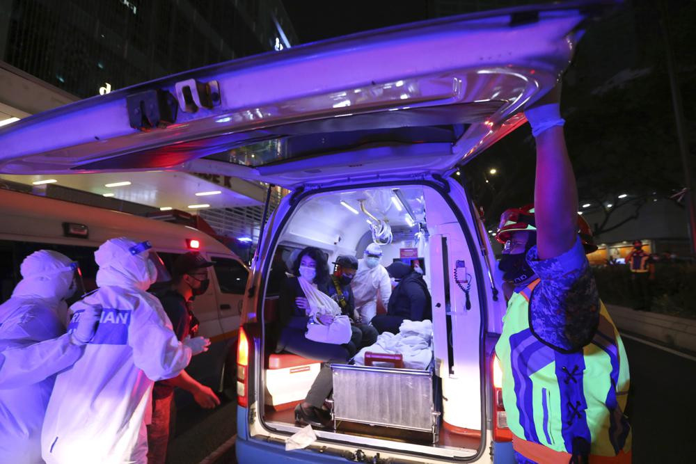 Rescue personnel help injured passengers at KLCC station after two light rail trains collided in a tunnel, injuring more than 200 people in Kuala Lumpur, Malaysia, Monday, May 24, 2021.
