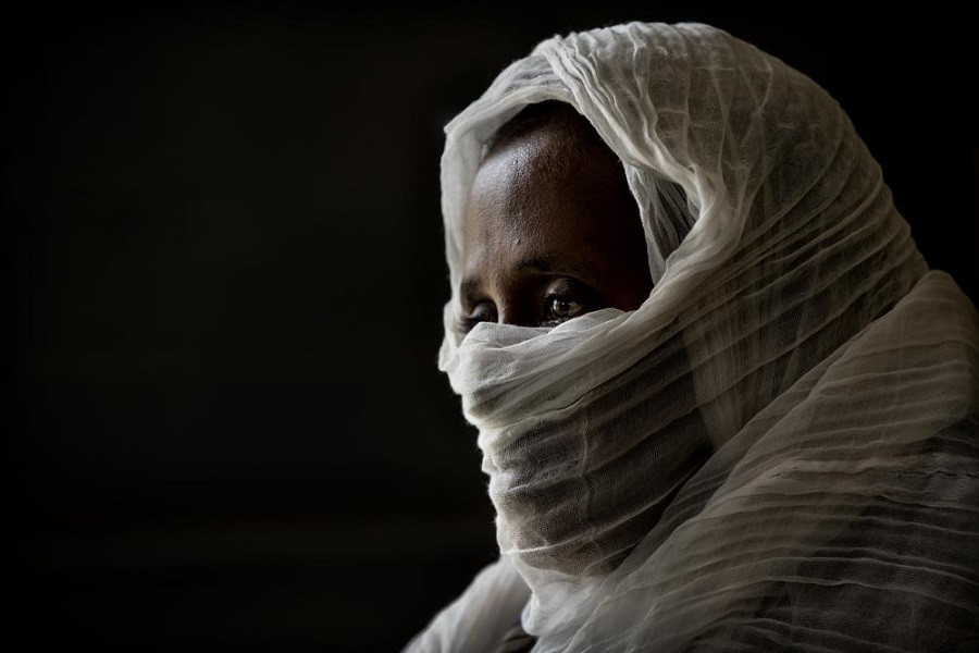 A 40-year-old woman who was says she was held captive and repeatedly raped by 15 Eritrean soldiers over a period of a week in a remote village near the Eritrea border.