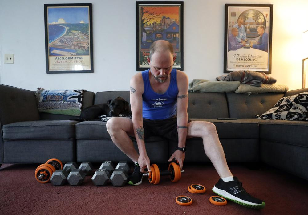 Christian Hainds prepares for a workout session at his home in Hammond, Indiana, Monday, June 7, 2021.