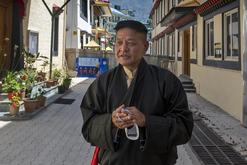 In this May 27, 2021, file photo, Penpa Tsering, the newly elected President of the Central Tibetan Administration, poses for a photograph after taking oath of office in Dharmsala, India.