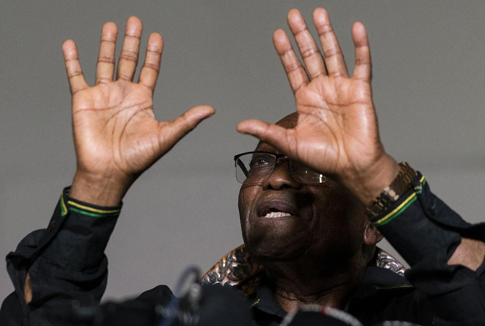 In this Sunday, July 4 2021, file photo former President Jacob Zuma gestures as he addresses the press at his home in Nkandla, KwaZulu-Natal Province, South Africa.