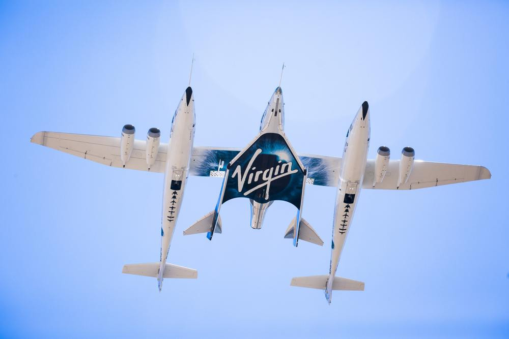 This Sept. 8, 2016 photo made available by Virgin Galactic shows the company's Spaceship Unity and Mothership Eve.