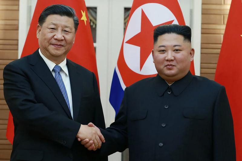 In this June 20, 2019, file photo provided by the North Korean government, North Korean leader Kim Jong Un, right, poses with Chinese President Xi Jinping for a photo at Kumsusan guest house in Pyongyang, North Korea.