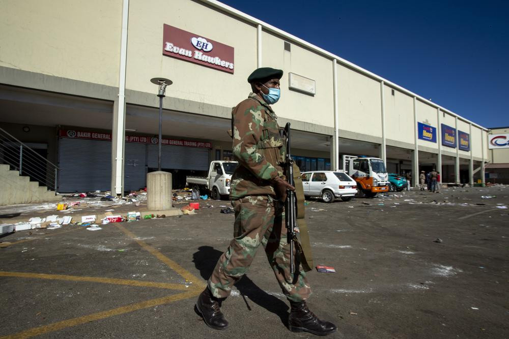 A soldiers patrol at a shopping centre in Soweto, Johannesburg Tuesday July 13, 2021.