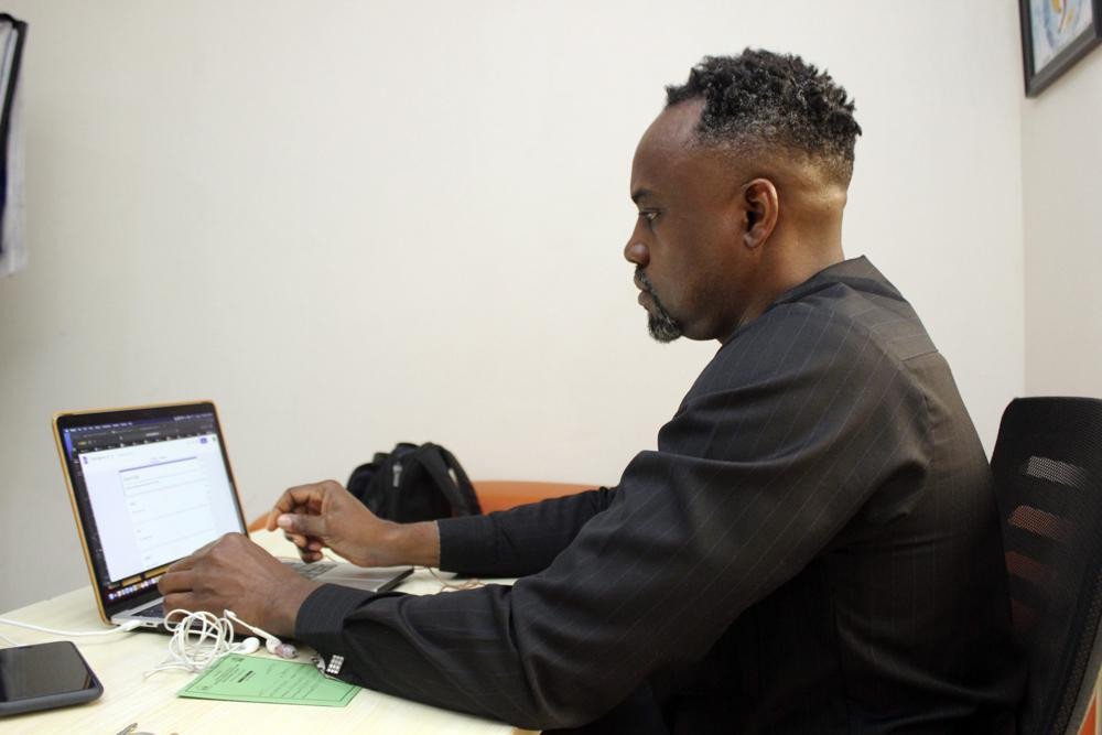 Dr. Ifeanyi Nsofor works on his laptop inside his office in Abuja, Nigeria, Monday, July 12, 2020.