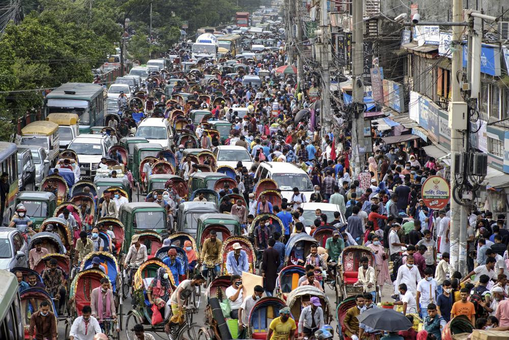 People crowd a market area ahead of Eid-al Adha in Dhaka, Bangladesh, Friday, July 16, 2021.