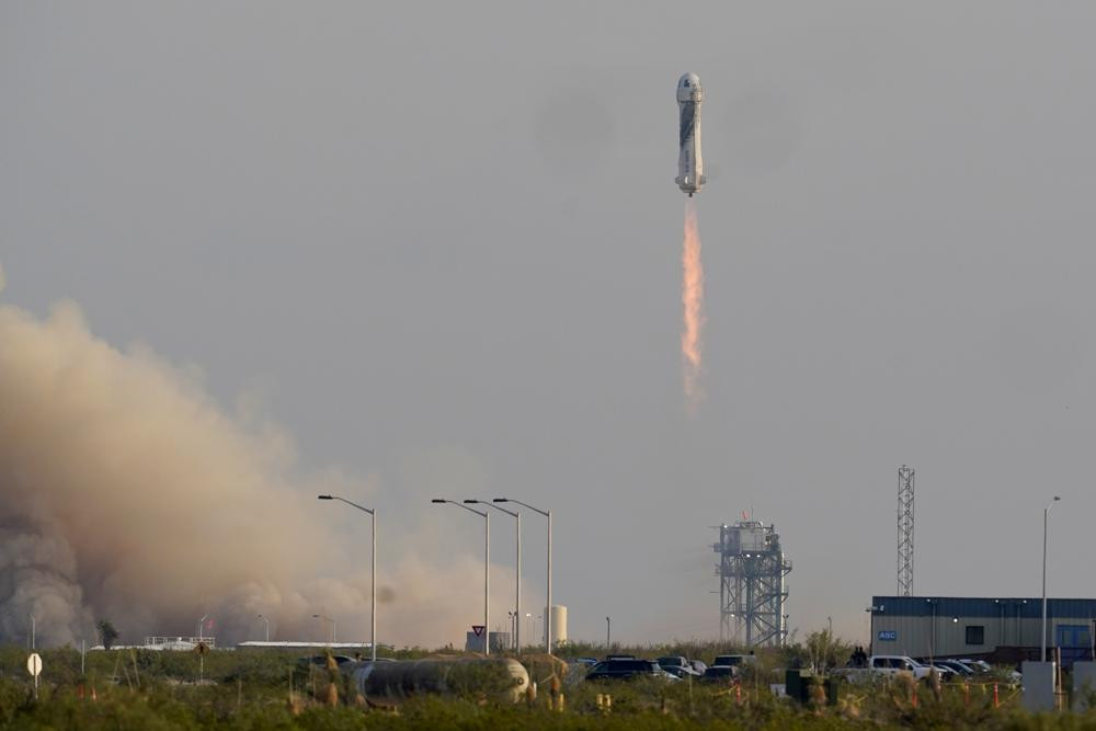 Blue Origin's New Shepard rocket launches carrying passengers Jeff Bezos, founder of Amazon and space tourism company Blue Origin, brother Mark Bezos, Oliver Daemen and Wally Funk, from its spaceport near Van Horn, Texas, Tuesday.