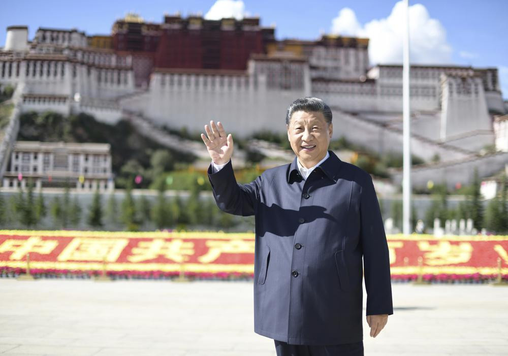 In this July 22, 2021 photo released by China's Xinhua News Agency, Chinese President Xi Jinping waves while visiting a public square below the Potala Palace in Lhasa in western China's Tibet Autonomous Region.