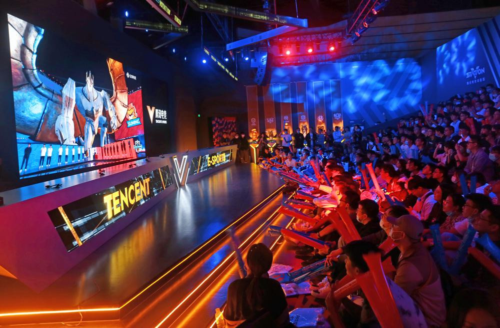 Fans watch the match of the 2020 League of Legends World Championship televised on a screen at a Tencent V-station in Shanghai, China, Oct. 31, 2020.