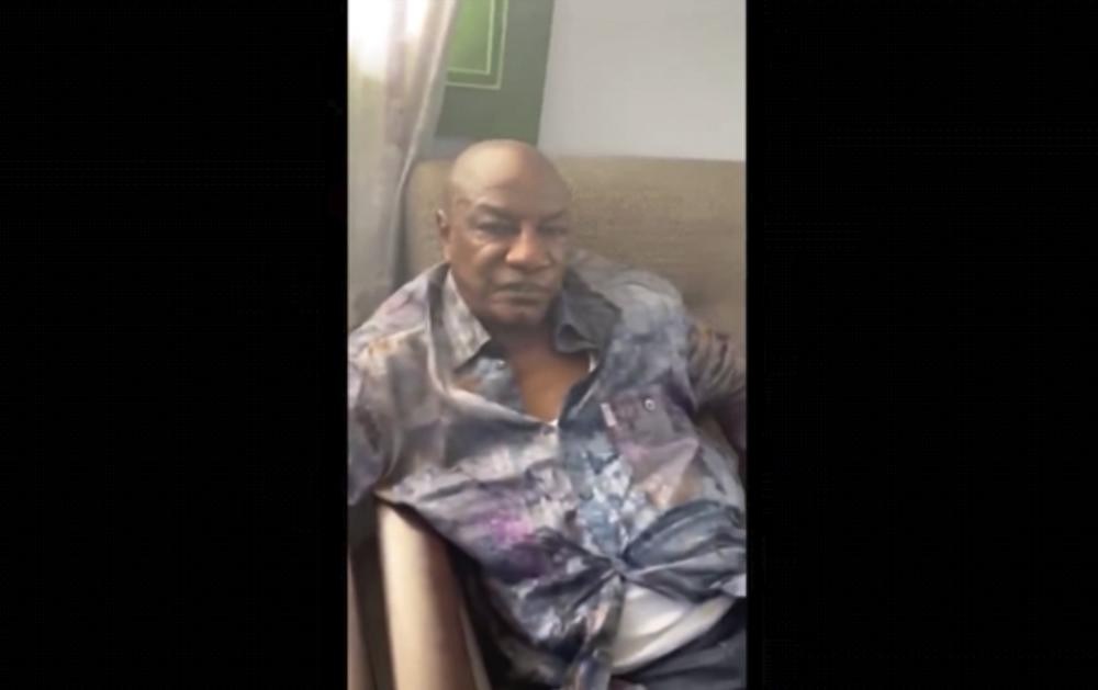 In this image made from video on Sunday, Sept. 5, 2021, Guinean President Alpha Conde sits on a sofa in an unknown location.