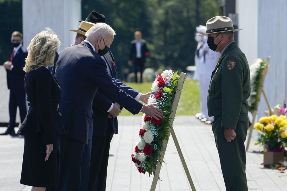 US President Joe Biden and first lady Jill Biden lay a wreath at the Wall of Names during a visit to the Flight 93 National Memorial in Shanksville, Pa., Saturday, Sept. 11, 2021.