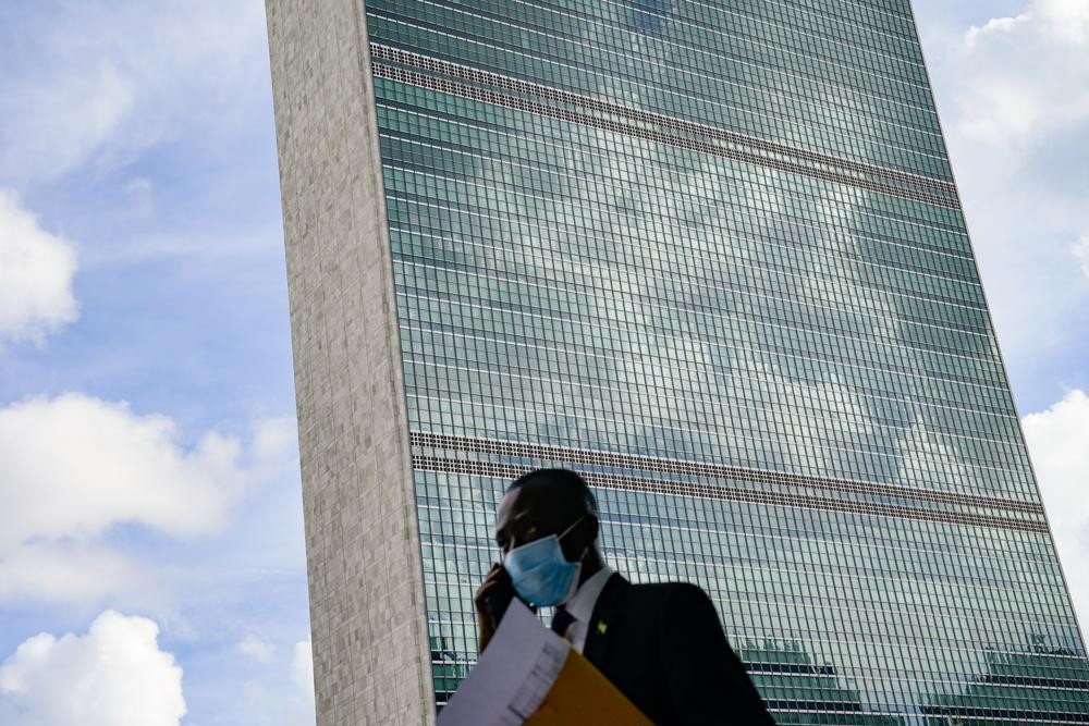 A pedestrian passes outside the United Nations headquarters, Tuesday, Sept. 21, 2021, during the 76th Session of the U.N. General Assembly in New York.