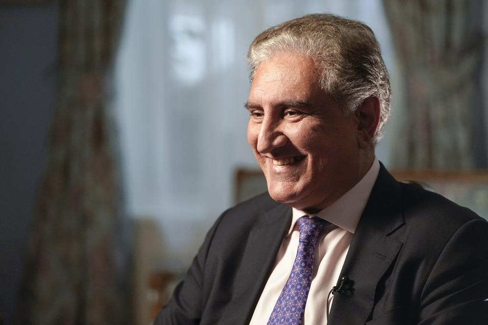 Pakistan's Foreign Minister Shah Mehmood Qureshi smiles during an interview with The Associated Press, Wednesday, Sept. 22, 2021, in New York.