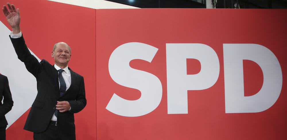 Olaf Scholz, Finance Minister and SPD candidate for Chancellor, waves during the election party at Willy Brandt House in Berlin, Sunday, Sept. 26, 2021.
