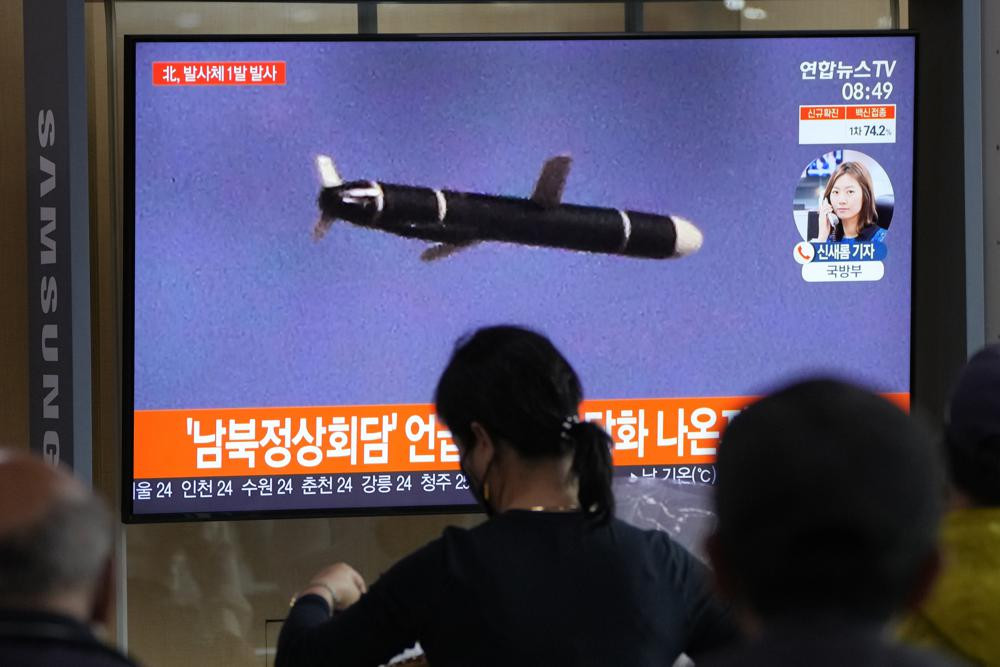 People watch a TV showing a file image of North Korea's missile launch during a news program at the Seoul Railway Station in Seoul, South Korea, Tuesday, Sept. 28, 2021.