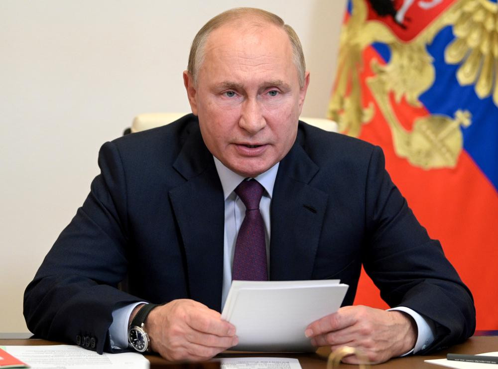 Russian President Vladimir Putin chairs a Security Council meeting via video conference at the Novo-Ogaryovo residence outside Moscow, Russia, in this Monday, Sept. 27, 2021, file photo.