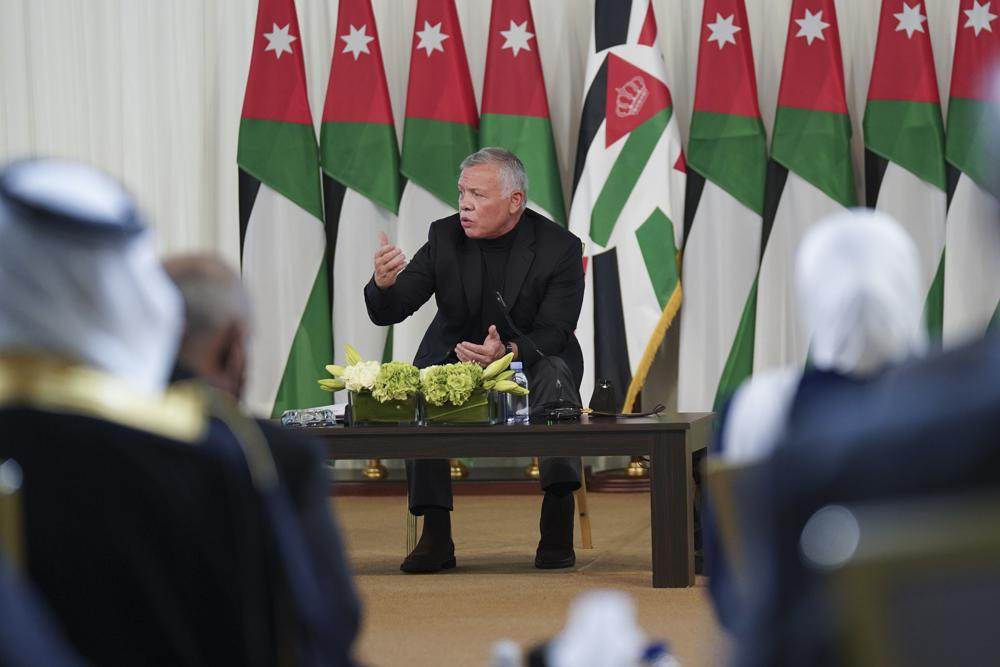 Jordan's King Abdullah II speaks during a meeting with tribal leader in Al-Qasta, south of Amman, Jordan, Monday, Oct. 4, 2021.