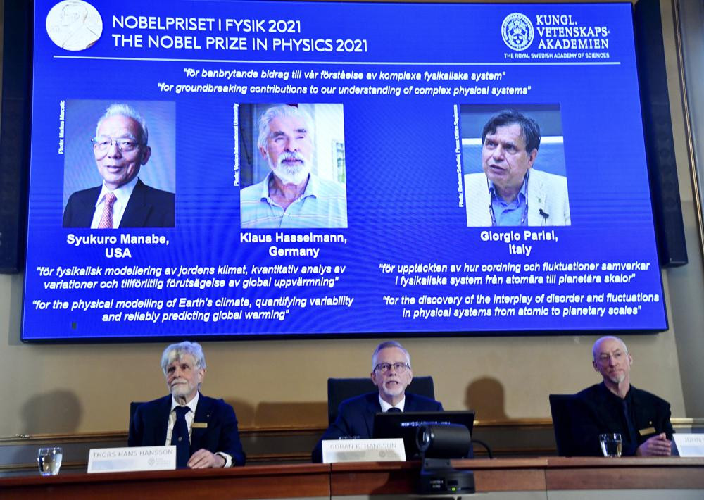 Secretary General of the Royal Swedish Academy of Sciences Goran Hansson, center, announces the winners of the 2021 Nobel Prize in Physics at the Royal Swedish Academy of Sciences, in Stockholm, Sweden, Tuesday, Oct. 5, 2021.