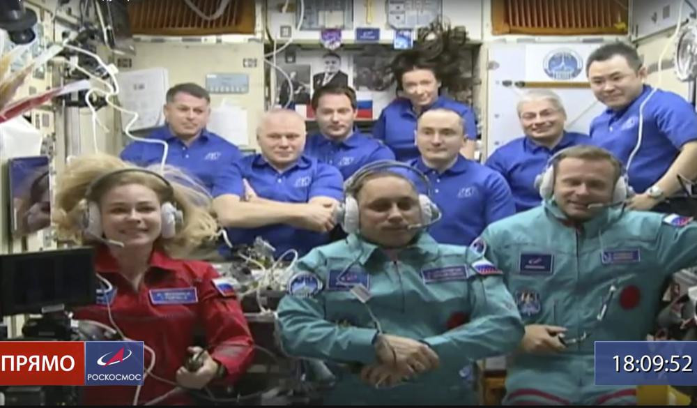Actress Yulia Peresild, left, film director Klim Shipenko, right, and cosmonaut Anton Shkaplerov sit in the first row among other participants of the mission in the International Space Station.