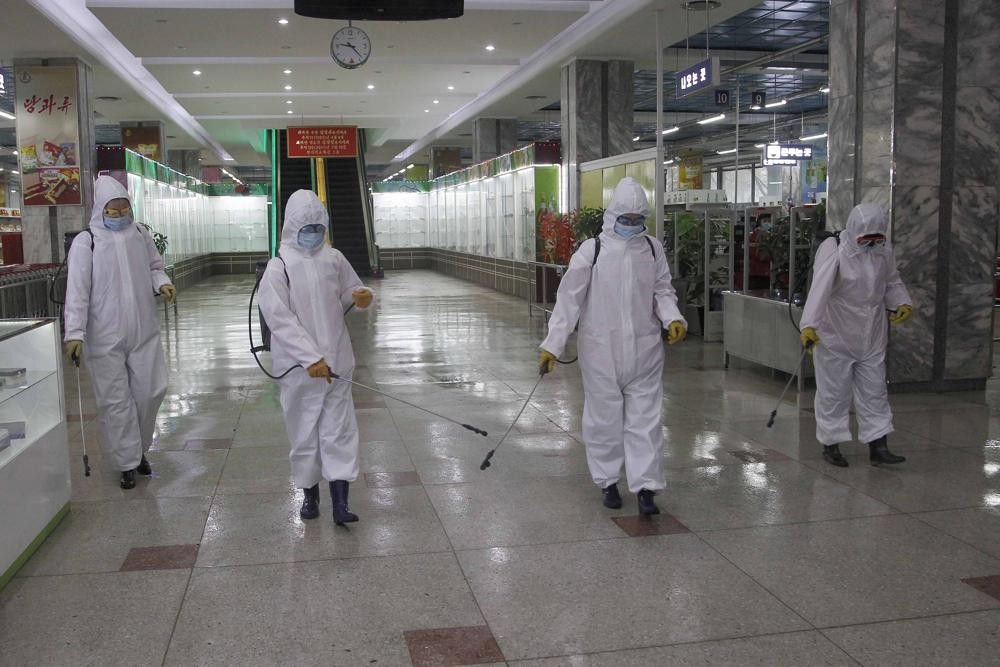 In this Dec. 28, 2020, file photo, staff of the Pyongyang Department Store No. 1 disinfect the store to help curb the spread of the coronavirus before it opens in Pyongyang, North Korea.