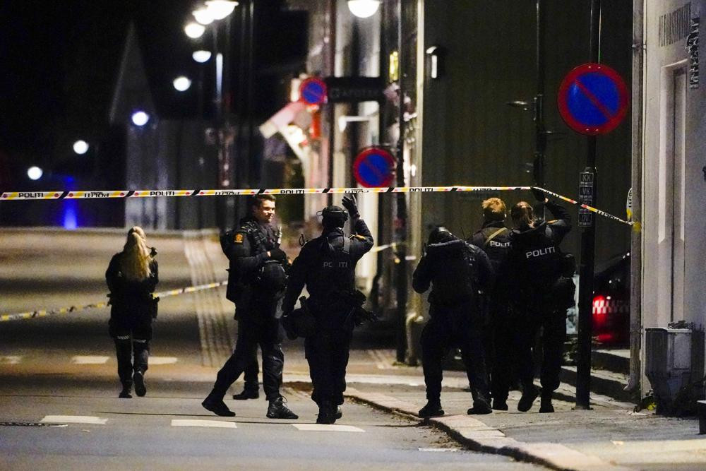 Police stand at the scene after an attack in Kongsberg, Norway, Wednesday, Oct. 13, 2021.
