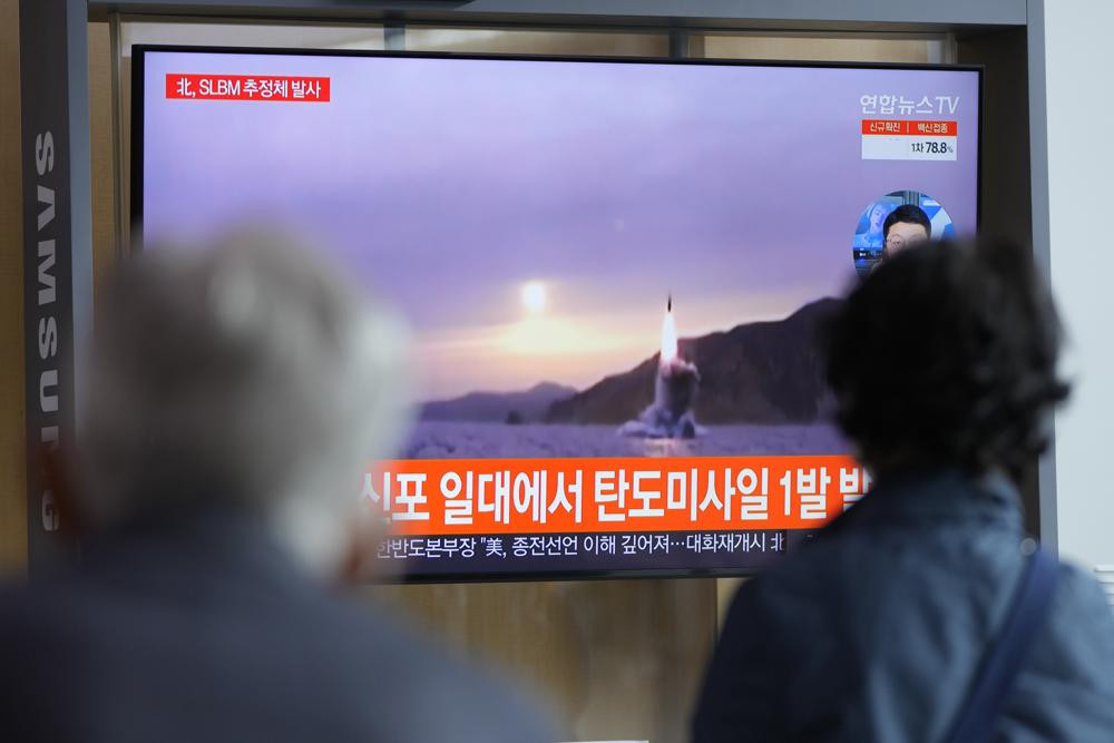 People watch a TV screen showing a news program reporting about North Korea's missile launch with file footage at a train station in Seoul, South Korea, Tuesday, Oct. 19, 2021.