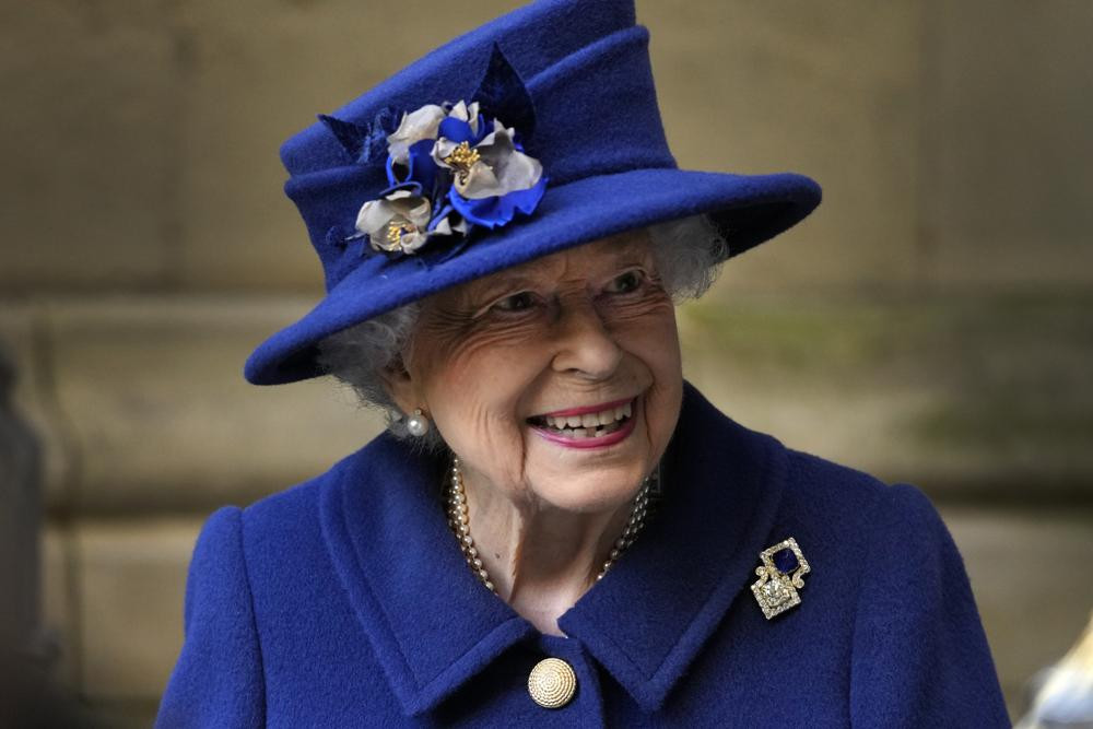 In this Tuesday, Oct. 12, 2021 file photo, Britain's Queen Elizabeth II, Patron, leaves after attending a Service of Thanksgiving to mark the Centenary of the Royal British Legion at Westminster Abbey, in London.