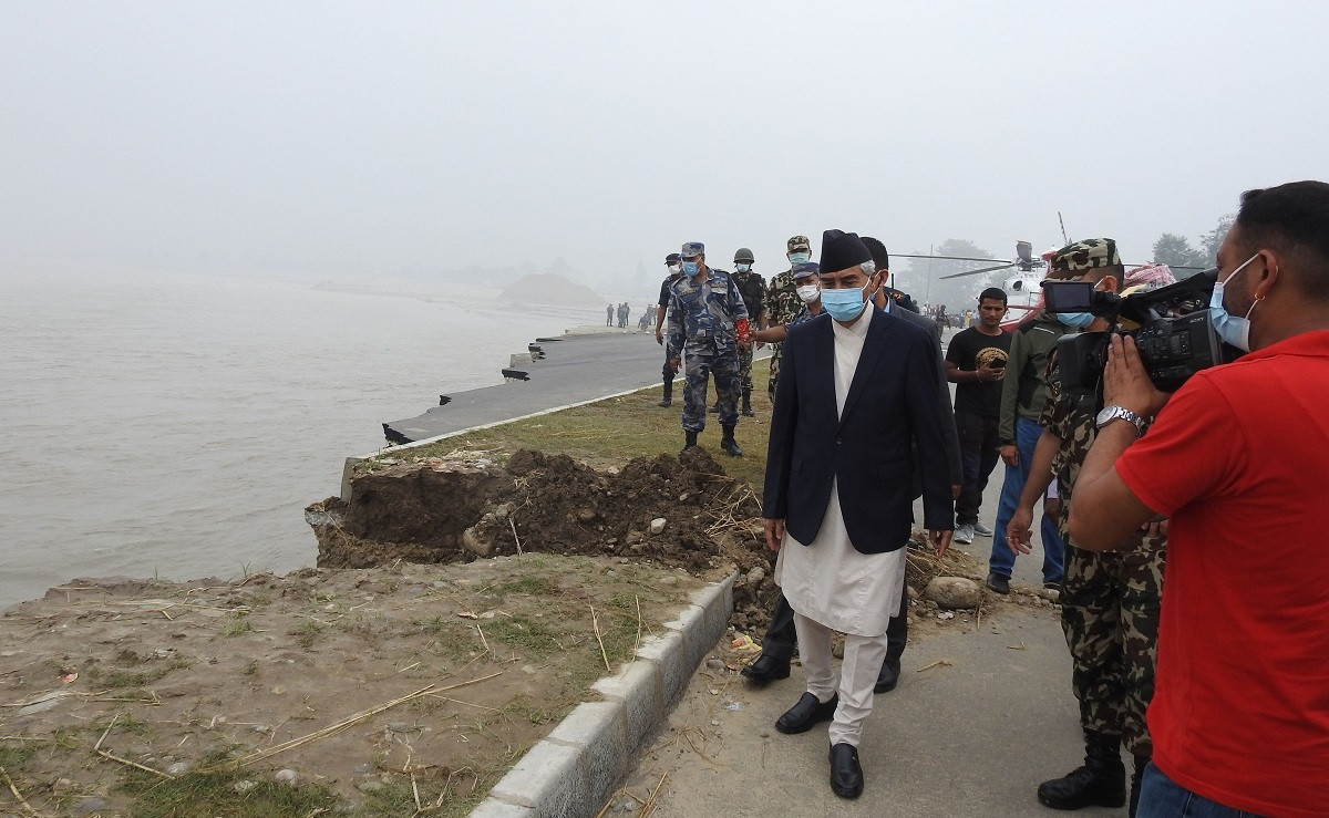 File Photo of Deuba inspecting flood-hit areas in Far West