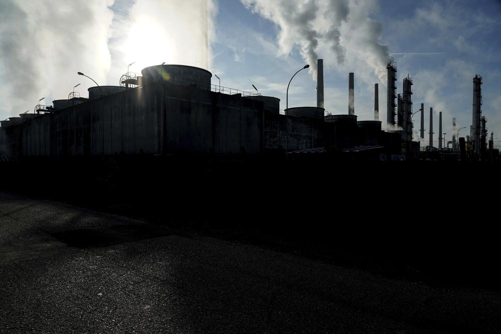 In this Oct. 15, 2021 file photo, smoke rises from the Feyzin Total refinery chimneys, outside Lyon, central France.