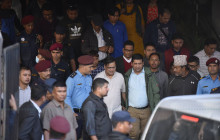 Krishna Bahadur Mahara (white shirt beside the police officer) being taken from the Kathmandu District Court after the eharing on Tuesday. Photo: Narayan Maharjan/Setopati
