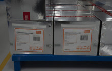 Boxes of SARS CoV-2 Vaccine for COVID-19 stamped with the words