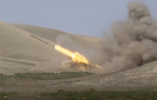 In this image taken from footage released by Azerbaijan's Defense Ministry on Sunday, Sept. 27, 2020, an Azerbaijan's rocket launches from missile system at the contact line of the self-proclaimed Republic of Nagorno-Karabakh, Azerbaijan.