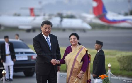 President Bidya Devi Bhandari welcomes her Chinese counterpart Xi Jinping at the TIA on Saturday. Photo: Narayan Maharjan