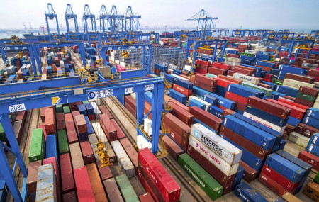 In this May 14, 2019, fiel photo, containers are piled up at a port in Qingdao in east China's Shandong province.