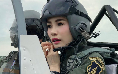 This undated photo posted Monday, Aug. 26, 2019, on the Thailand Royal Office website shows Major General Sineenatra Wongvajirabhakdi, the royal noble consort of King Maha Vajiralongkorn, in an aircraft cockpit.