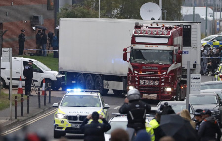 Police escort the truck, that was found to contain a large number of dead bodies, as they move it from an industrial estate in Thurrock, south England, Wednesday Oct. 23, 2019.